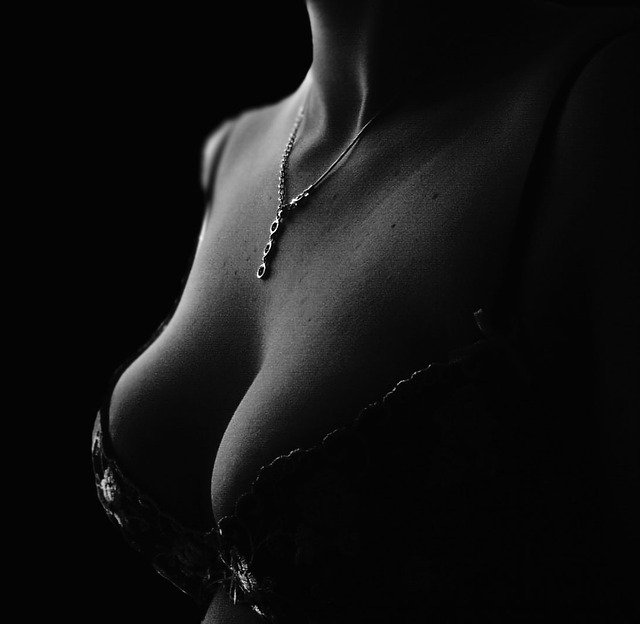 woman's breasts in a play of shadow and light